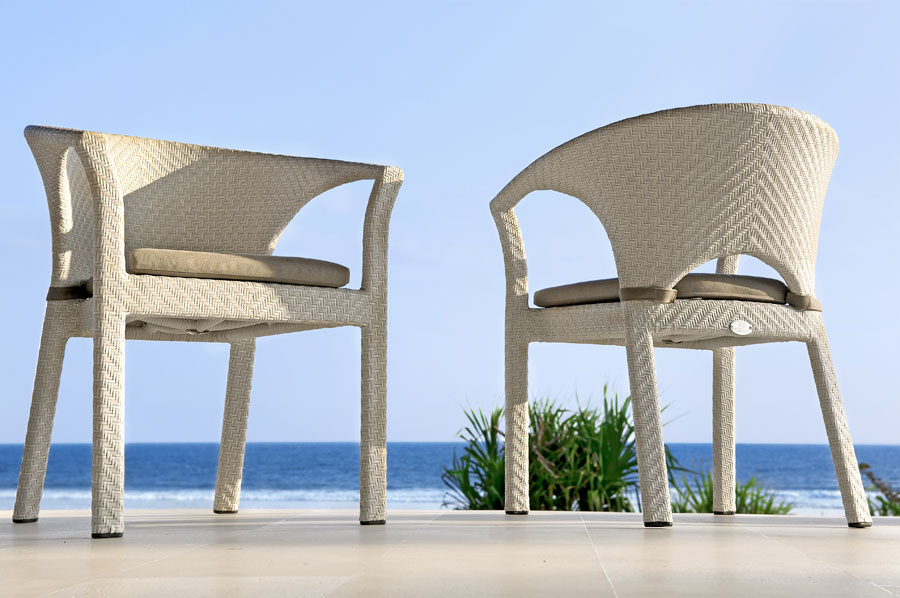 White ergonomical synthetic wicker chairs