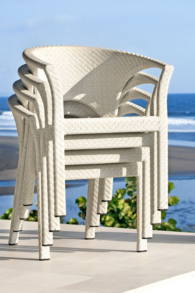White stackable synthetic wicker chairs