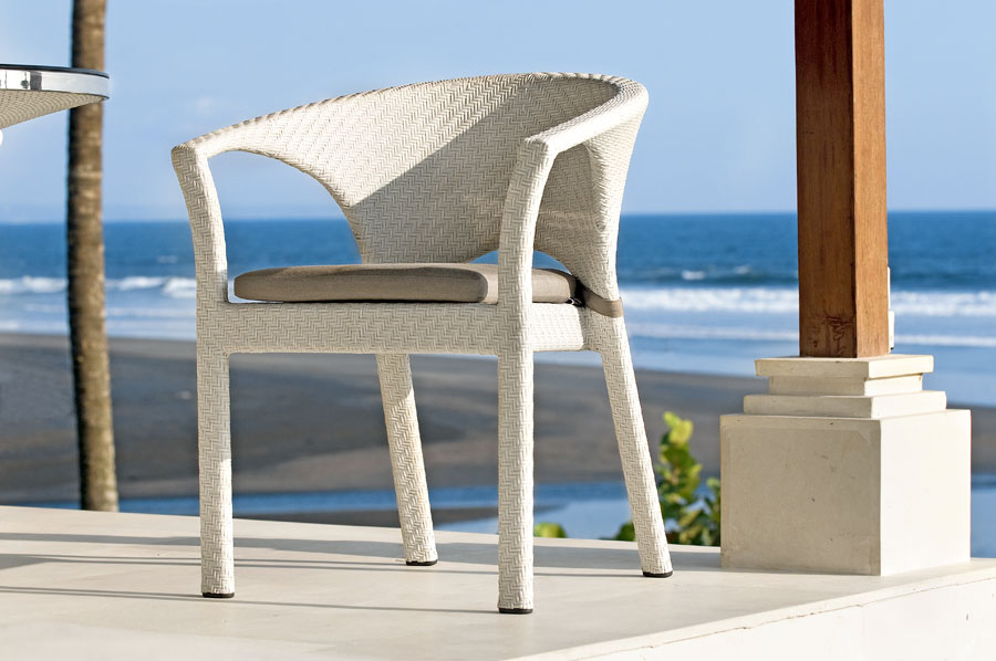 White synthetic wicker chair with Sumbrella pillow